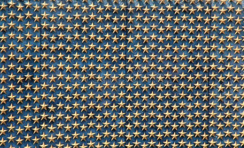 Gouden sterren op de muur royalty-vrije stock foto's