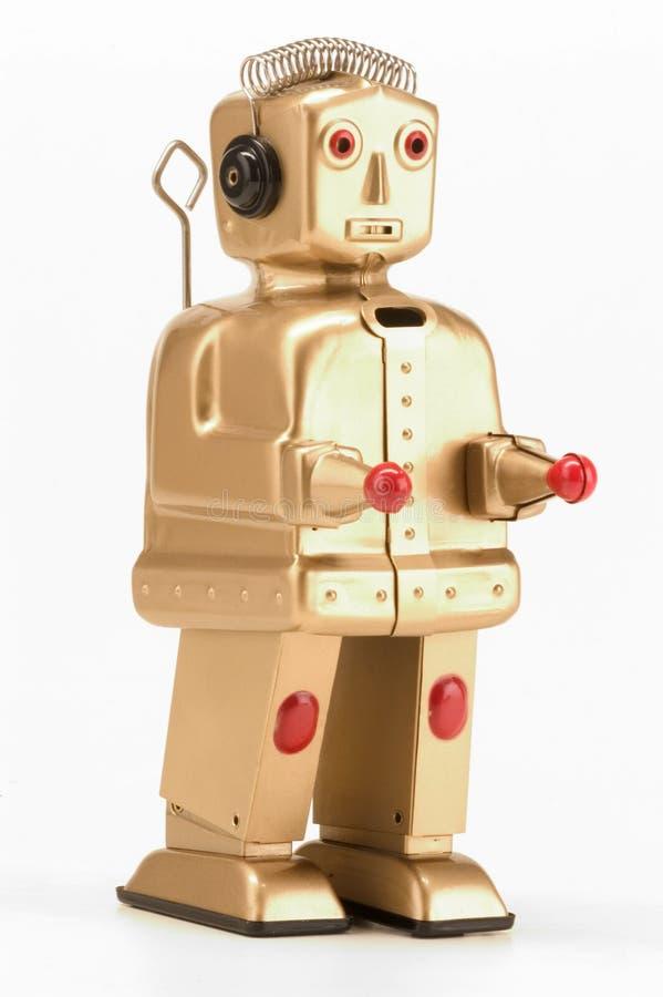 Gouden stuk speelgoed robot royalty-vrije stock foto's