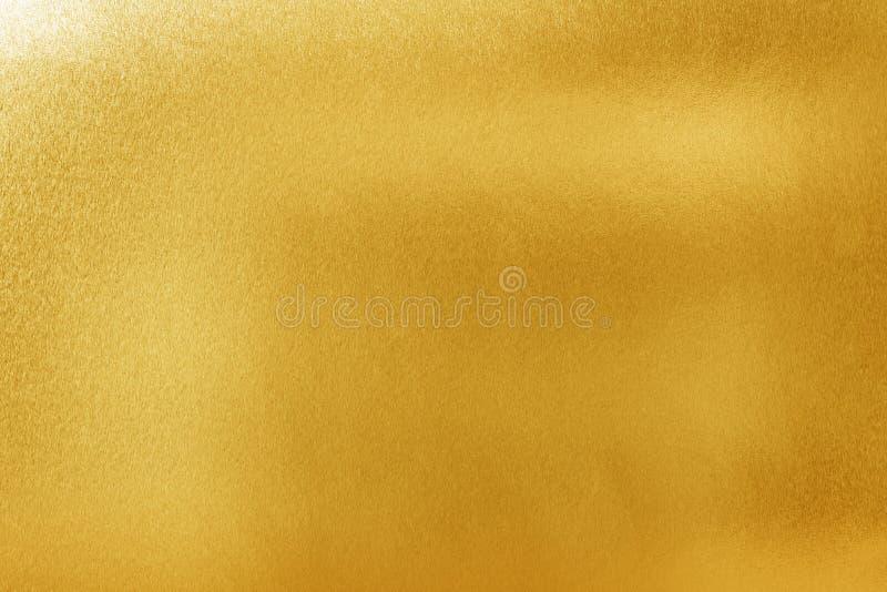 gouden textuurachtergrond voor ontwerp Glanzend geel metaal of folieoppervlaktemateriaal stock fotografie