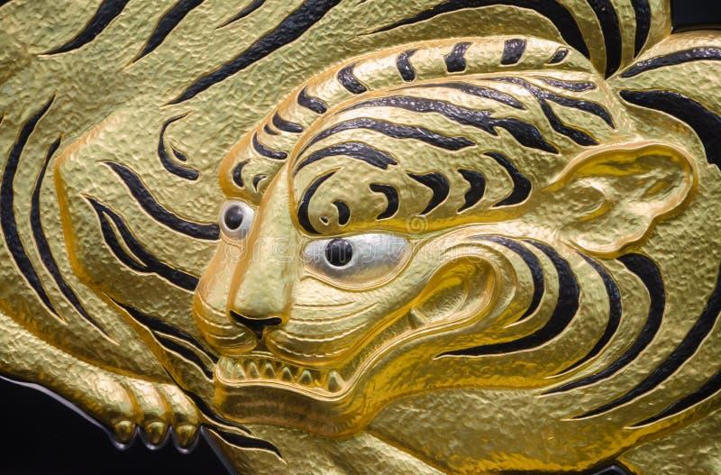 Gouden tijger stock afbeeldingen