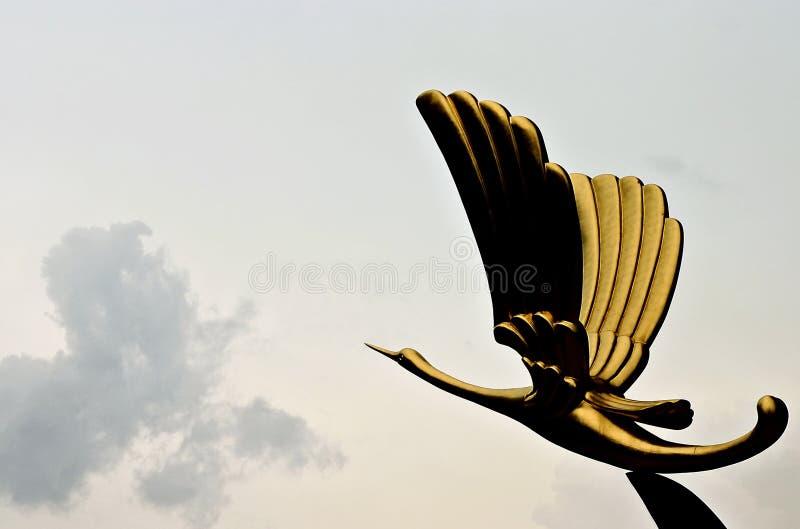 Gouden vogelstandbeeld royalty-vrije stock afbeelding