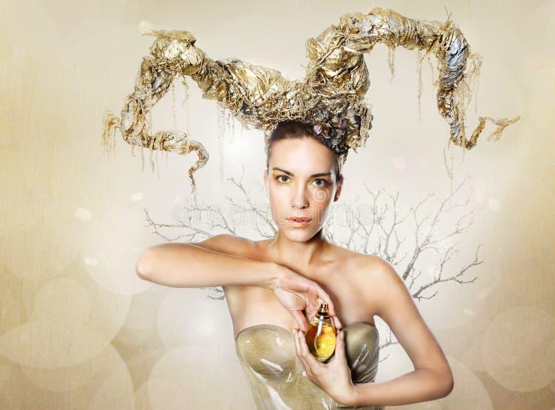 Gouden vrouw stock foto