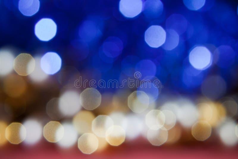 Gouden, witte en blauwe fonkelingen royalty-vrije stock foto