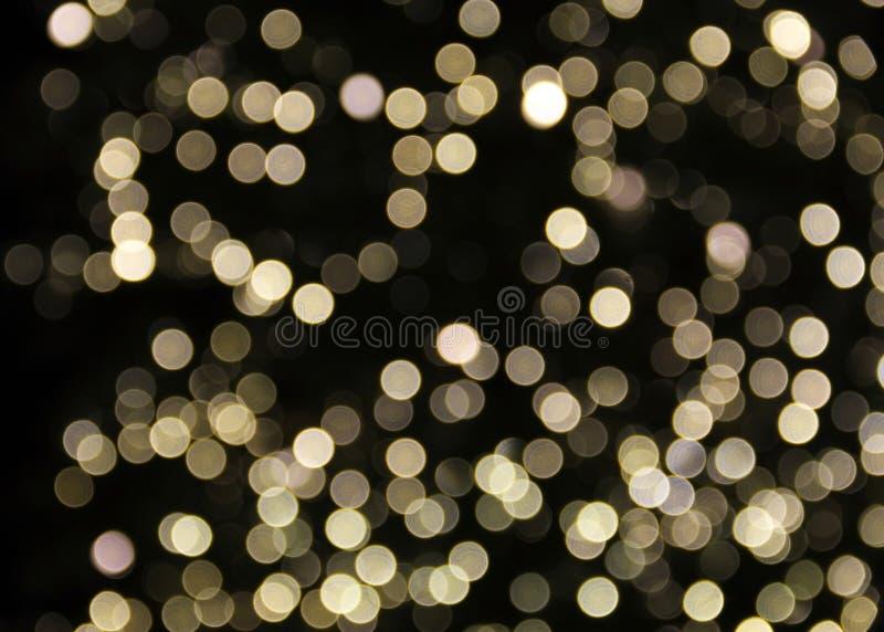 Gouden Witte Lichte Onduidelijk beeldachtergrond royalty-vrije stock afbeeldingen