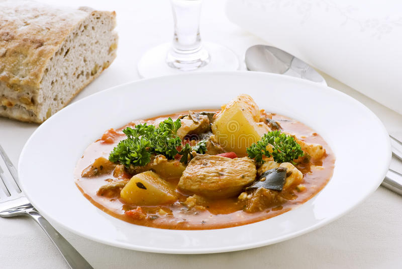 Goulash. Hot goulash with bread as closeup in a plate stock photo