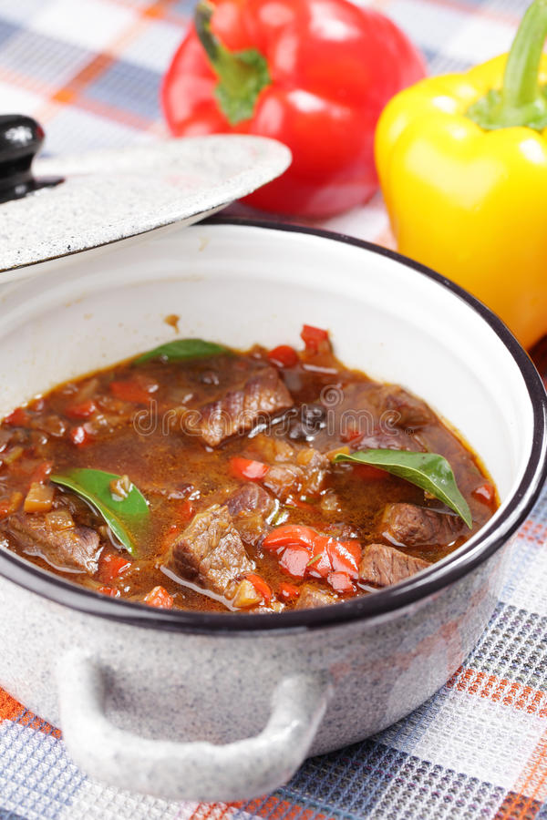 Goulash. Prepared goulash in the enamel pot stock image