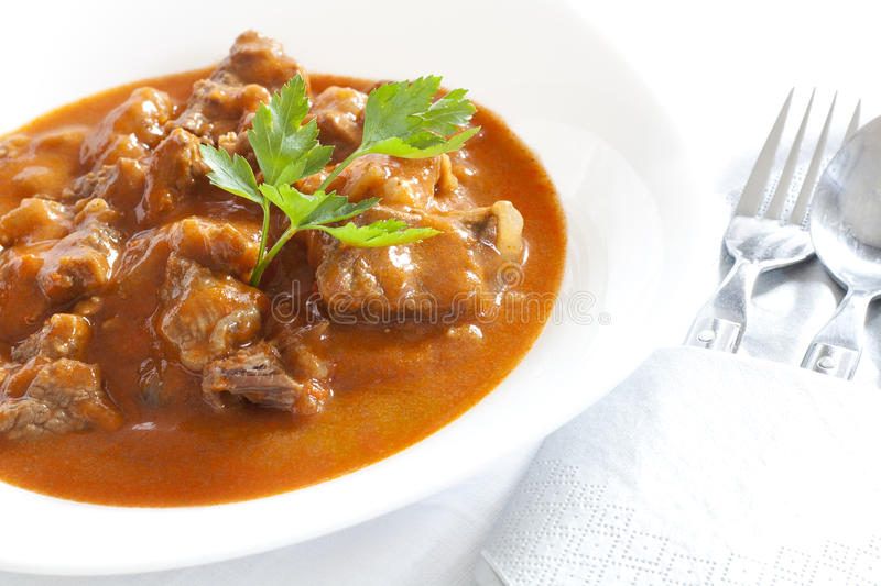 Goulash. Stew with parsley served in white bowl stock image