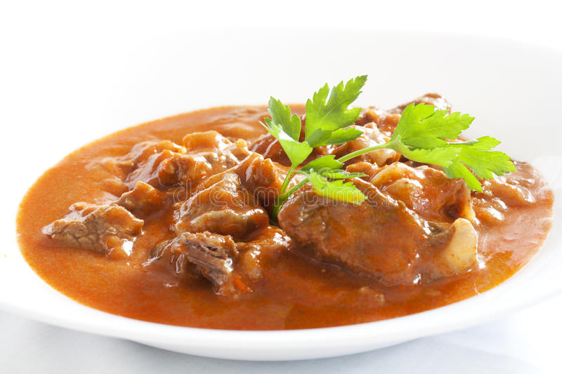 Goulash. Stew with parsley served in white bowl royalty free stock photo