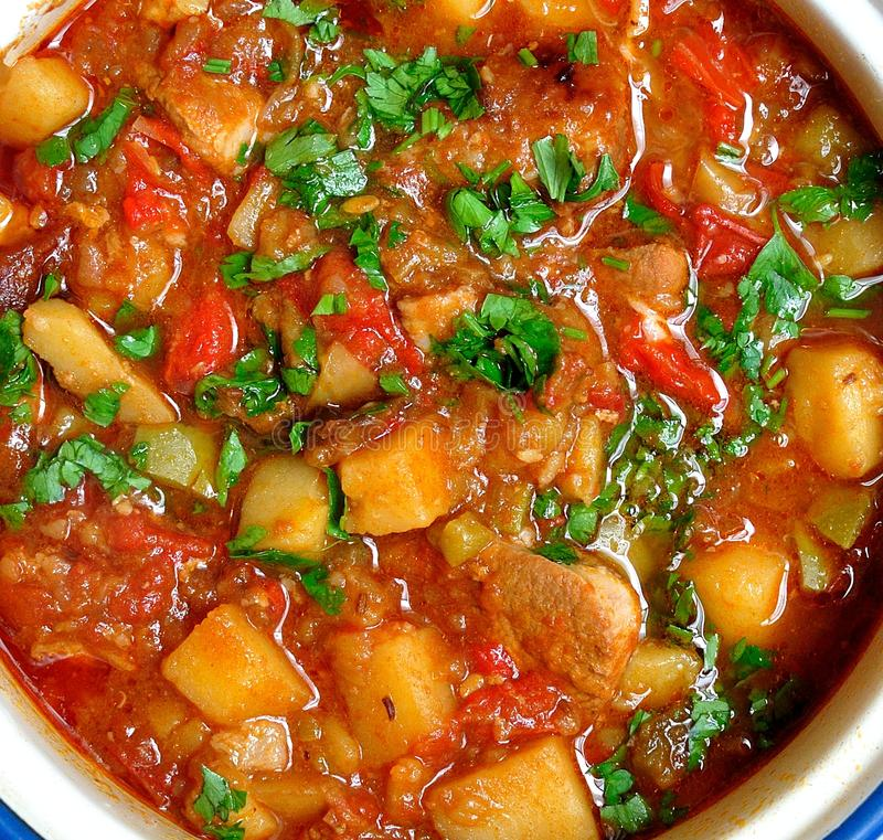 Goulash. Crock pot of beef goulash, ready to serve. Lovely warming food royalty free stock image