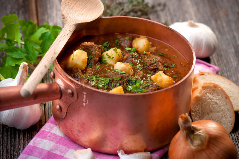 Goulash. Traditional goulash in copper pot, ready to eat stock photo
