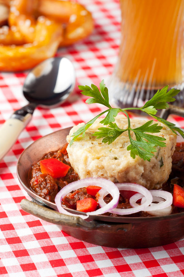 Goulash with dumpling. On red plaid stock image