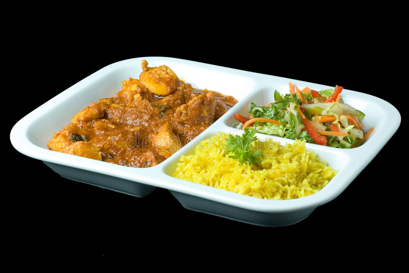 Goulash portion. Sectioned portion of goulash (mixed meat), salad and rice isolated over black background stock images
