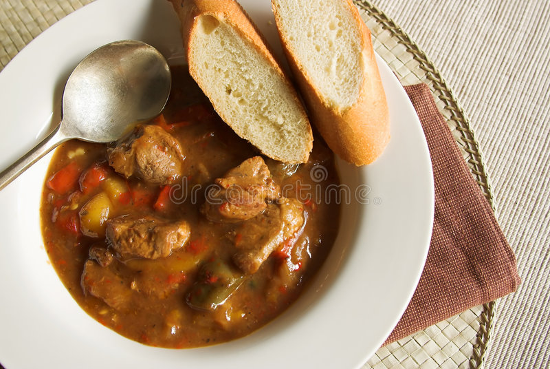 Goulash soup. Hearty bowl of homemade goulash soup with beef and peppers royalty free stock image