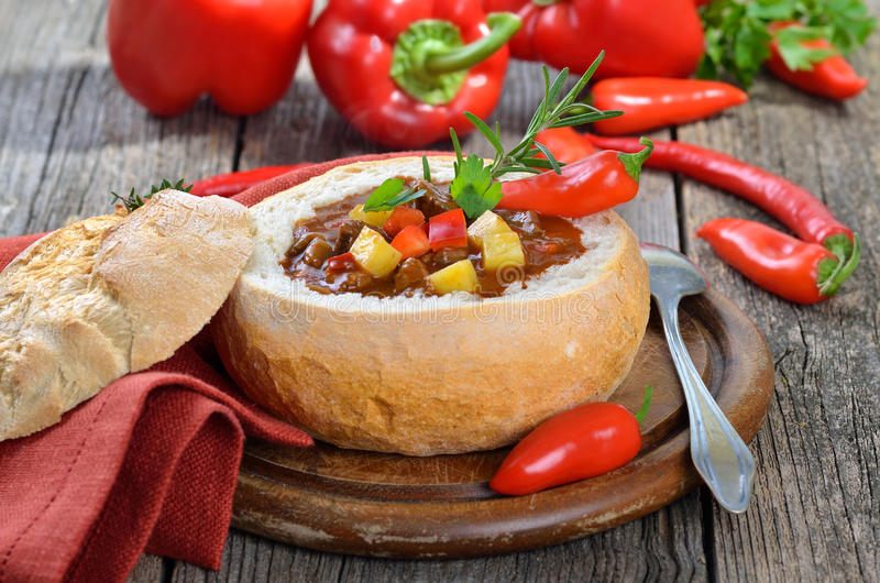 Goulash soup. Traditional hot Hungarian goulash soup in a white bread loaf royalty free stock photos