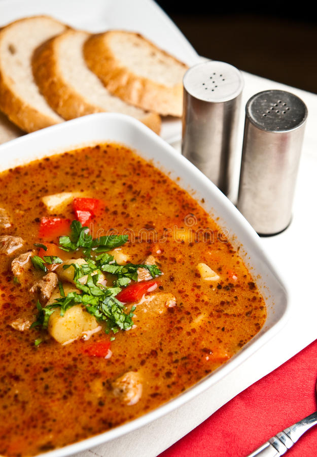 Goulash soup. A bowl of spicy goulash soup. Polish way of cooking a traditional Hungarian cuisine stock photo