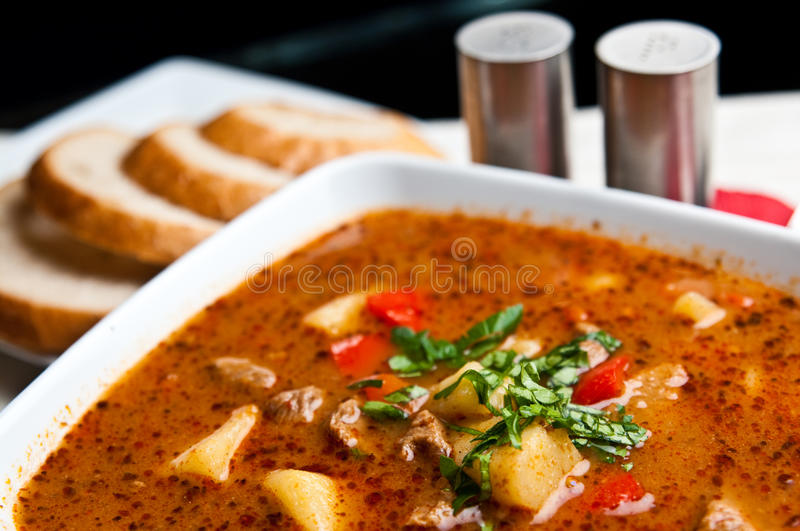 Goulash soup. A bowl of spicy goulash soup. Polish way of cooking a traditional Hungarian cuisine stock images