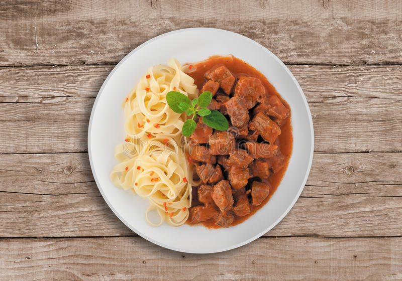 Goulash soup. With spaghetti. A Serbian traditional dish made from beef and pork royalty free stock image