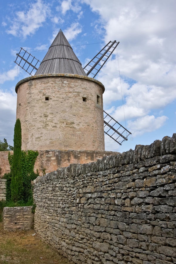 Goult's Jerusalem Windmill. A stone wall leads to the Jerusalem Windmill in Goult, France stock photos