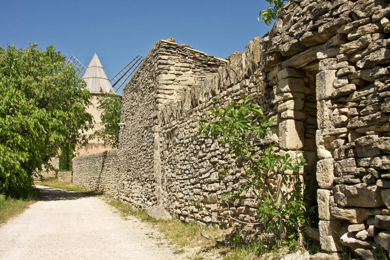 Goult's Jerusalem Windmill. A stone wall leads up to the Jerusalem Windmill in Goult, France royalty free stock images