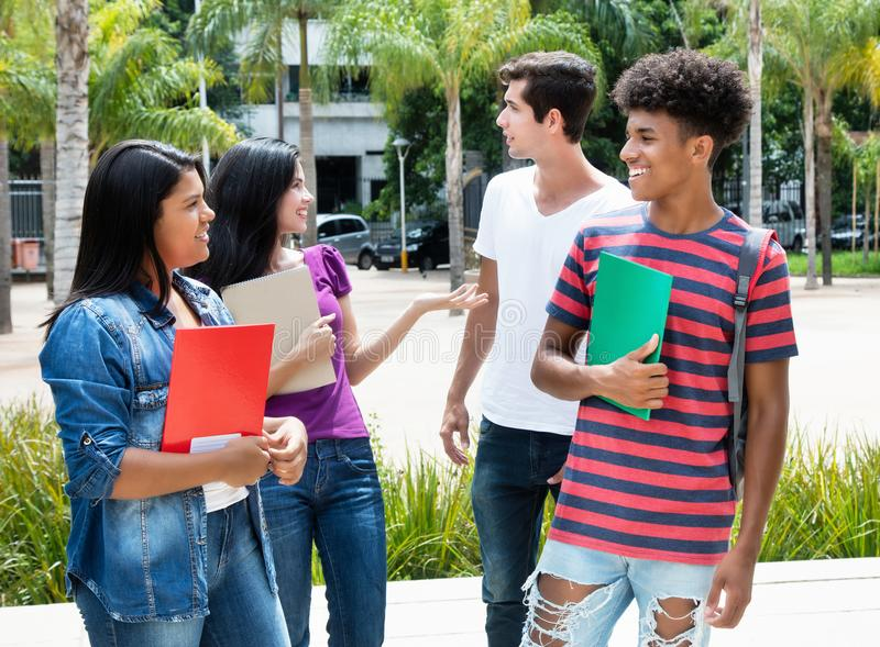 Goup of talking international students royalty free stock photo