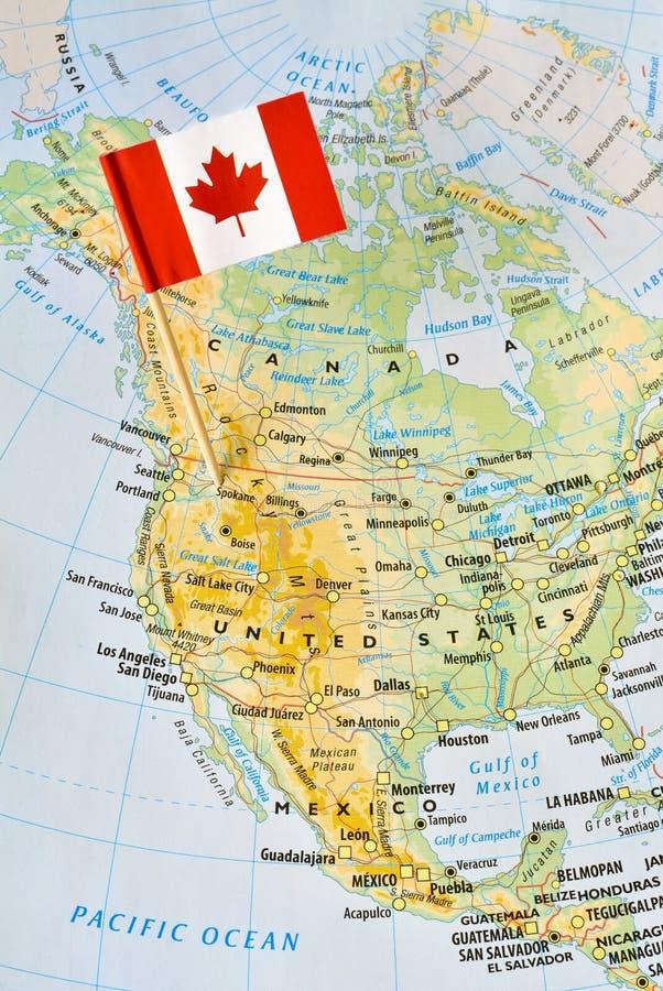 Goupille de drapeau de Canada sur la carte images libres de droits