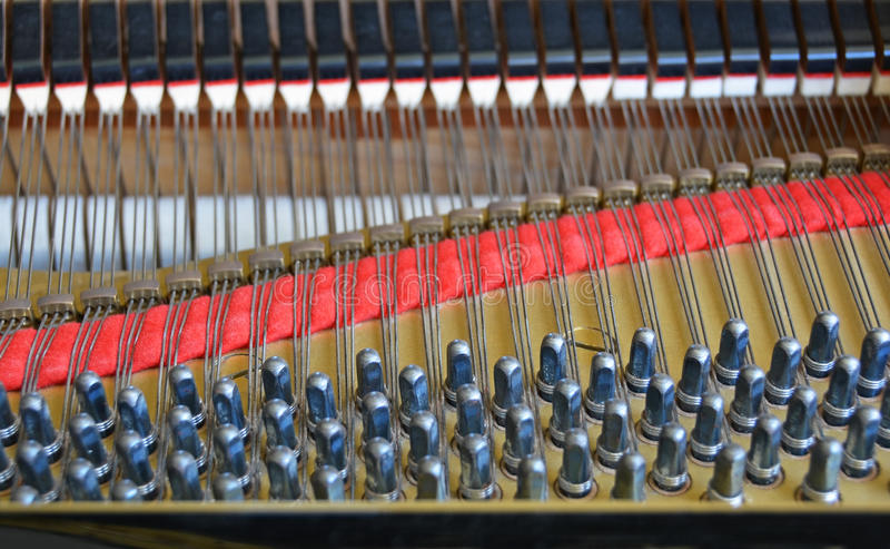 Goupilles de piano à queue et feutre de accord comportants abstraits d'amortisseur photo libre de droits