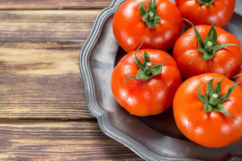 Gourmato maturo rosso saporito dei pomodori dalla fine del Belgio su, ingredie immagini stock