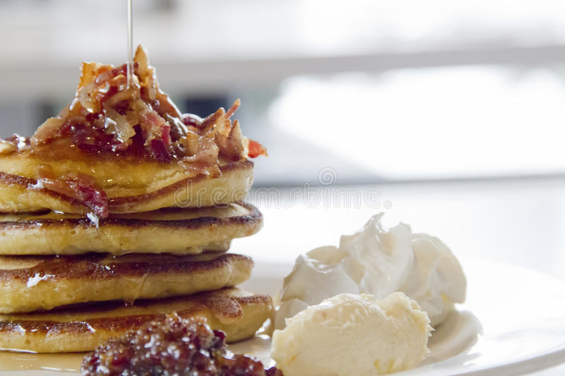 Gourmet breakfast pancakes with bacon bits stock photo