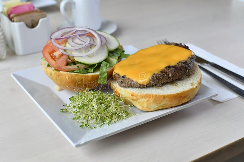 Gourmet Cheese Burger. Lettuce, tomatoes, cucumber, onions, quarter, pound, beef, black, angus, brussel, sprouts stock photography