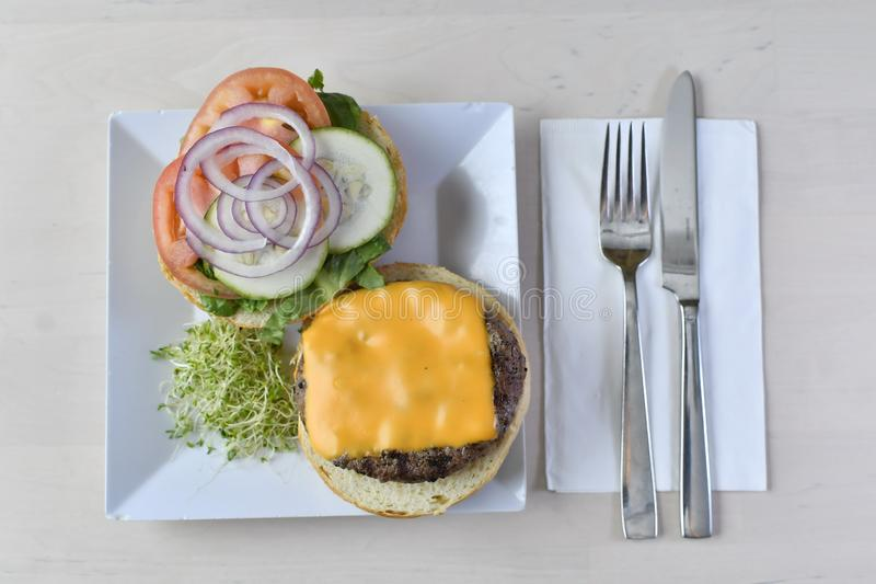 Gourmet Cheese Burger 2. Lettuce, tomatoes, cucumber, onions, quarter, pound, beef, black, angus, brussel, sprouts stock photos