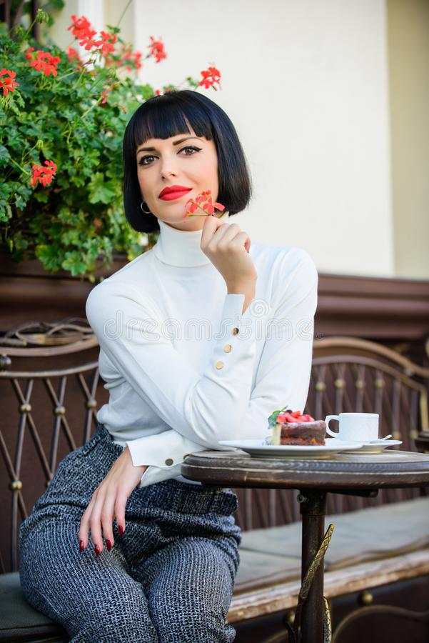 Gourmet concept. Pleasant time and relaxation. Delicious gourmet cake. Pamper yourself. Girl relax cafe with cake. Dessert. Woman attractive elegant brunette stock photography