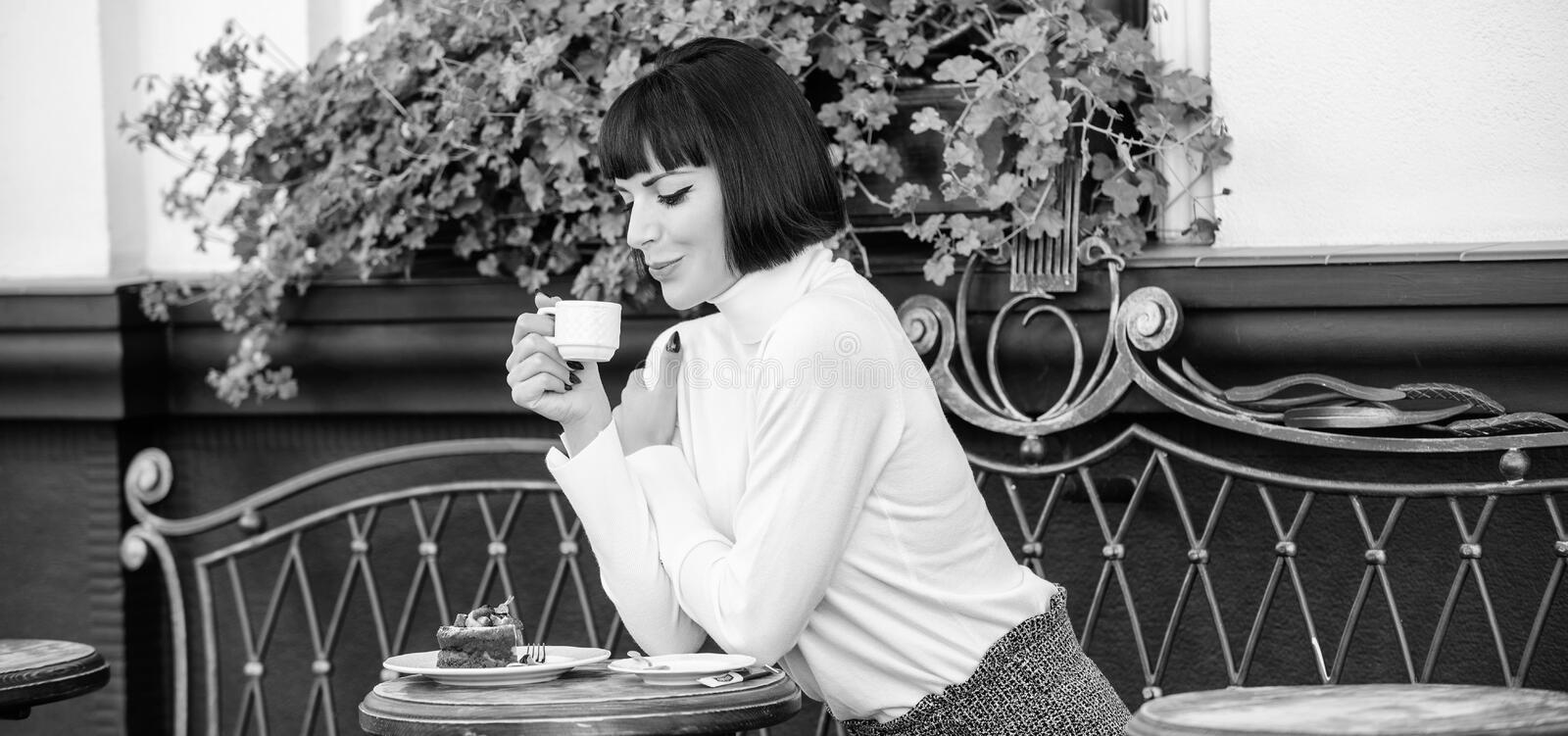 Gourmet concept. Pleasant time and relaxation. Delicious and gourmet drink. Girl relax cafe with coffee and dessert. Woman attractive elegant brunette enjoy royalty free stock images