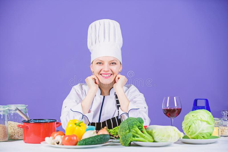 Gourmet cuisine is served here. Happy cook cooking delicious cuisine with vegetarian food. Sexy chef smiling with stock image