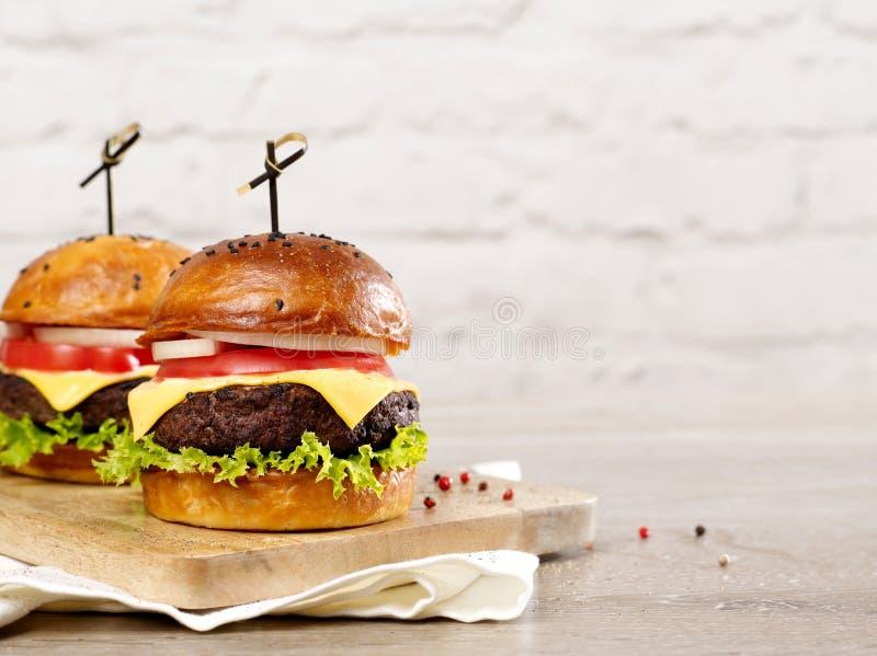 Cheeseburgers on cutting board stock photo