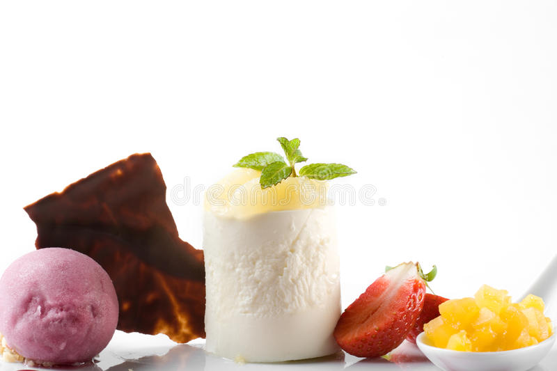 Gourmet dessert. Stylish gourmet dessert of mousse and fruits royalty free stock photo