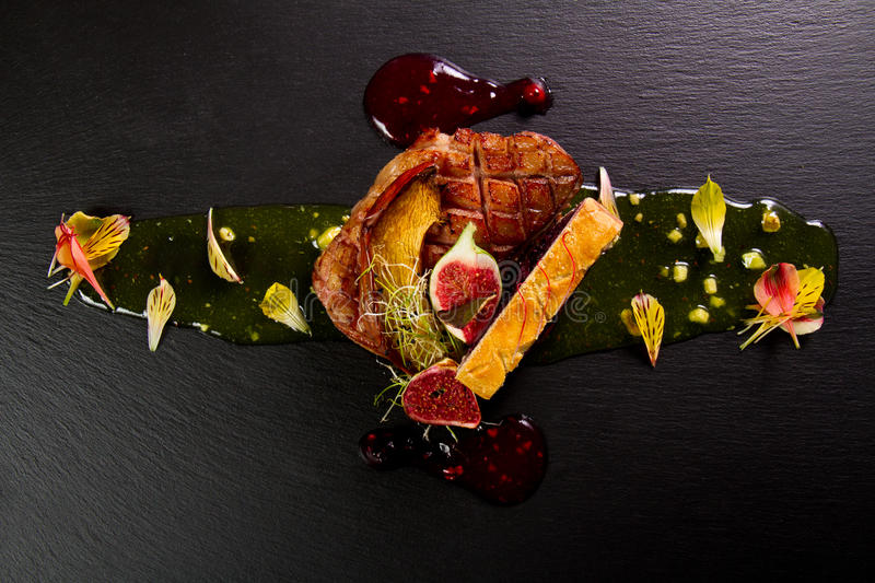 Gourmet duck dish. With onion jam and figs royalty free stock photo