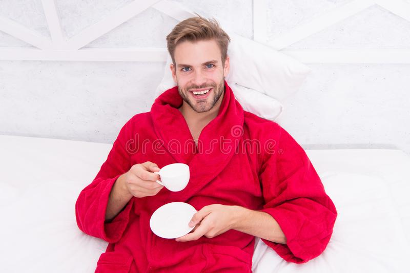 Gourmet espresso. Starting day with good coffee. Relaxing at home. Pleasant moments. Enjoy morning coffee. Happy morning. Handsome man drink morning coffee royalty free stock images