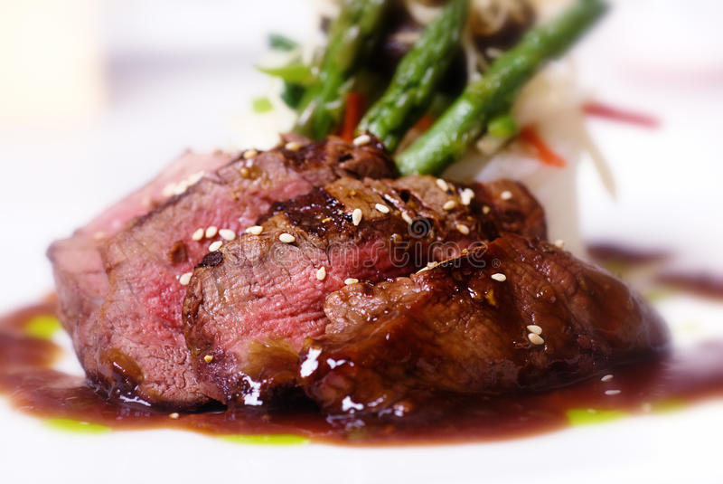 Gourmet fillet mignon steak. A gourmet fillet mignon steak at five star restaurant stock photos