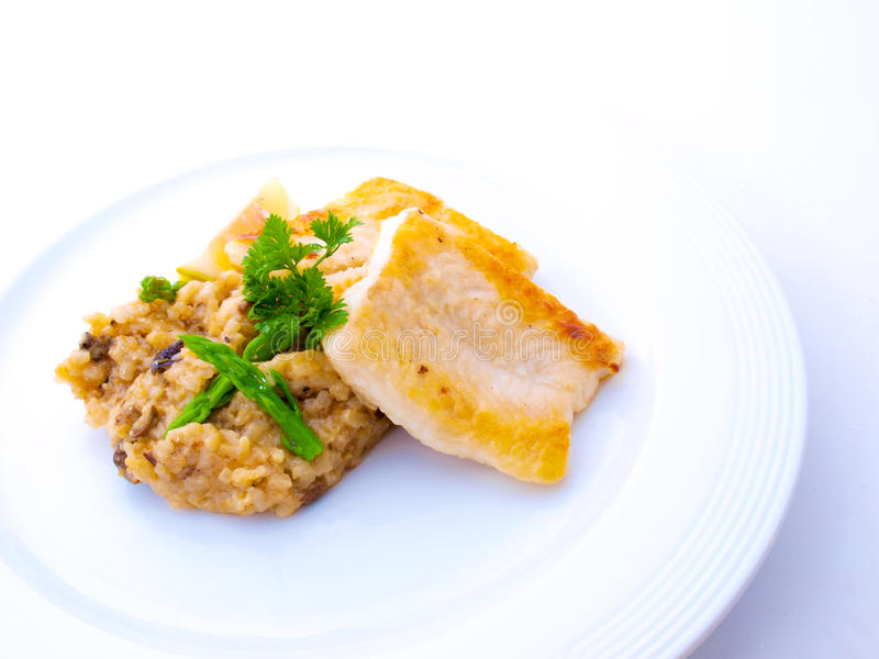 Gourmet Fish Fillet with Risotto on White Plate stock photo