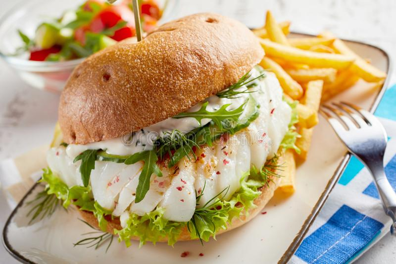 Gourmet fish seafood burger with mayo stock images