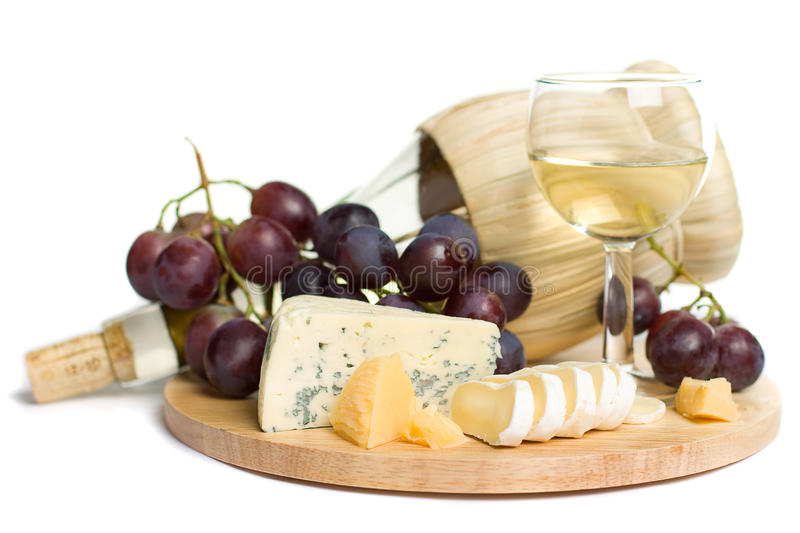 Gourmet food - wine, cheese and grapes royalty free stock image