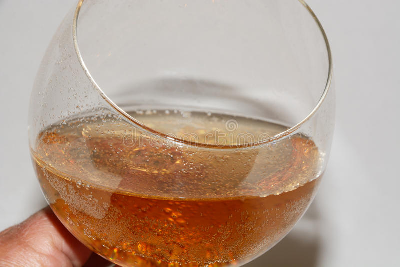 Gourmet ginger ale in wine glass stock photos
