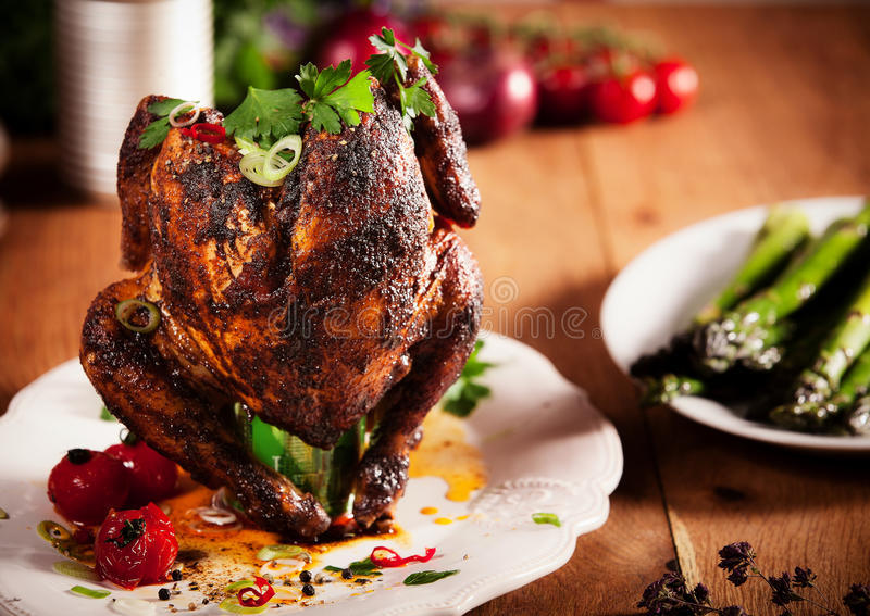 Gourmet Grilled Whole beer can Chicken on a White Plate royalty free stock photography
