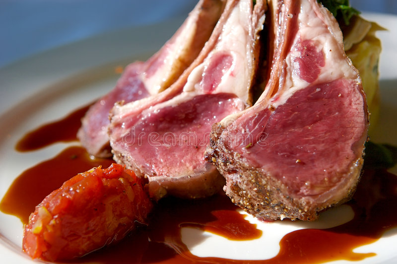 Gourmet Lamb Chops With Garnishes Stock Images