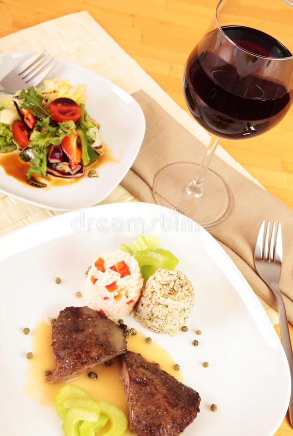 Gourmet meal with wine stock image