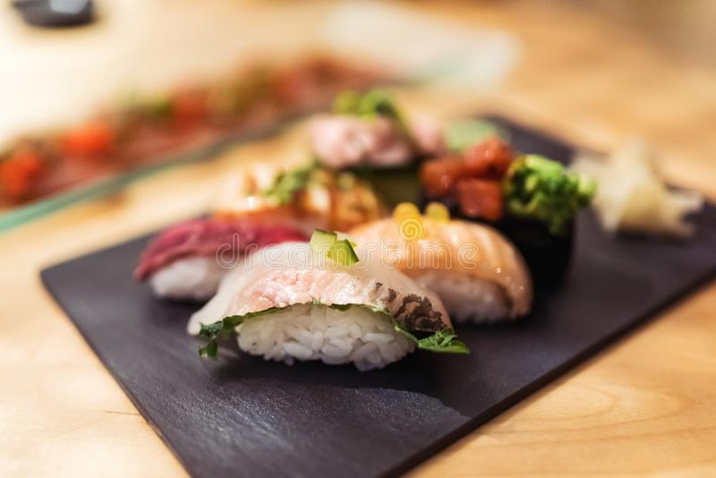 Gourmet nigiri moriawase set at restaurant. With tuna, haddock, crab, wagyu beef and soft shell crab stock photos