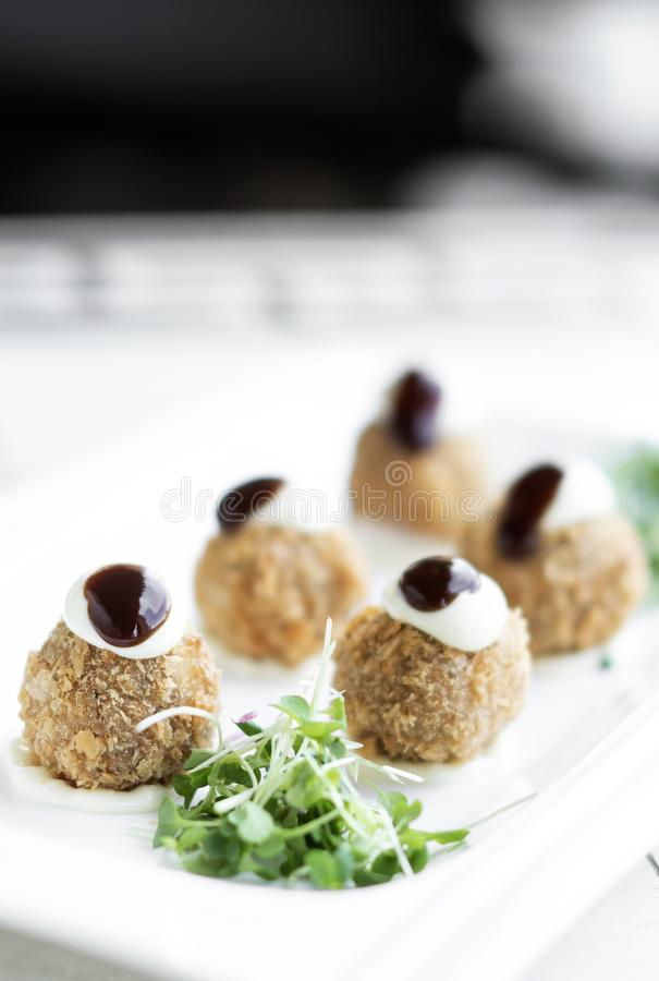 Gourmet organic scotch quail eggs starter snack on table royalty free stock image