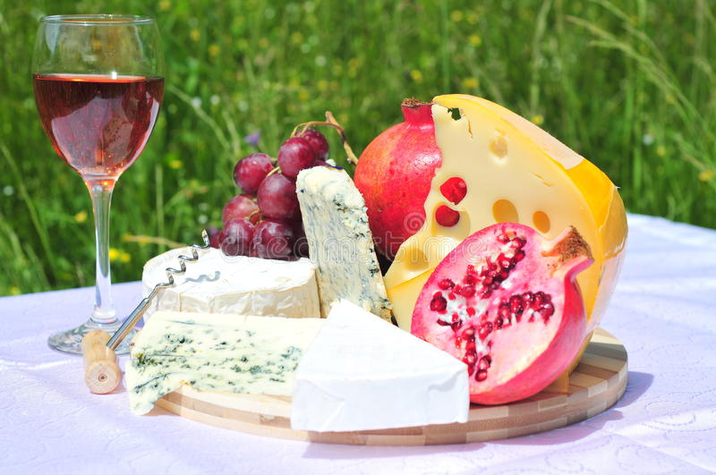 Gourmet plate (cheese, fruits and wine) royalty free stock photo