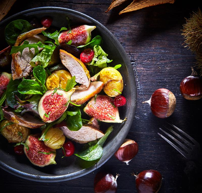 Gourmet roast pheasant, fig and chestnut salad royalty free stock photo