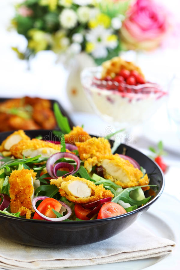 Gourmet salad with curry chicken stripes royalty free stock images